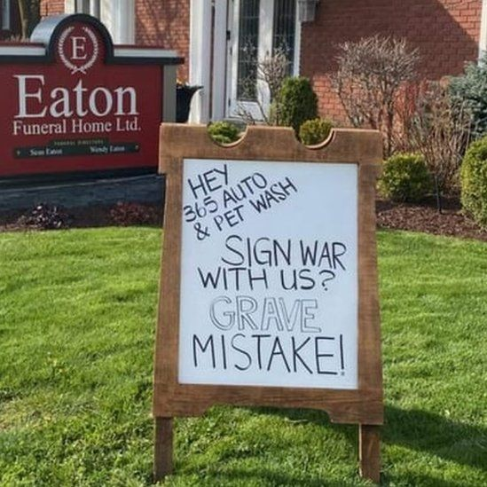 A sign at a funeral home reads 'Sign war with us? Grave mistake'