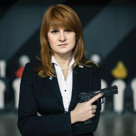 An undated handout picture showing Maria Butina posing with a gun