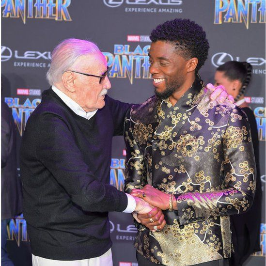 Stan Lee shakes Chadwick Boseman's hand