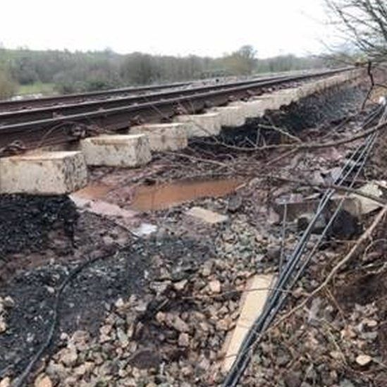 The rail bed has been washed from under rail lines