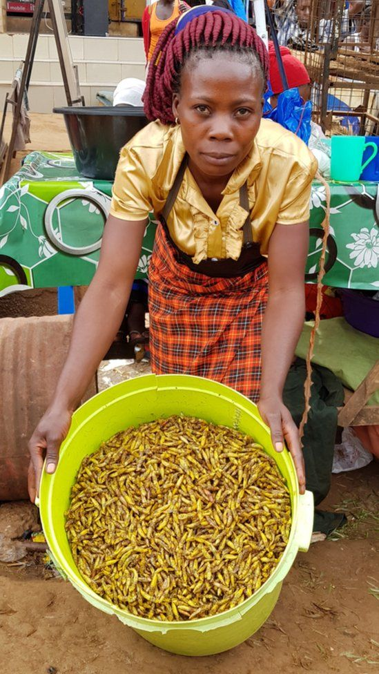 Woman selling grasshoppers