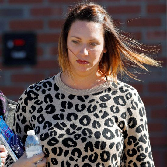 Shannon Allen, wife of former US Army Sergeant First Class Mark Allen, leaves court