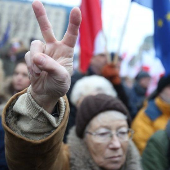 """Protesters attend a """"Free Media"""" demonstration in front of the Polish Television in Warsaw"""