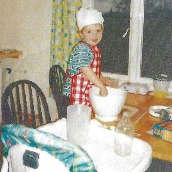Finlay Macdonald aged three in the kitchen