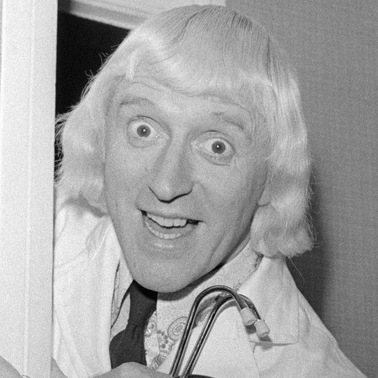Jimmy Savile carrying a stethoscope