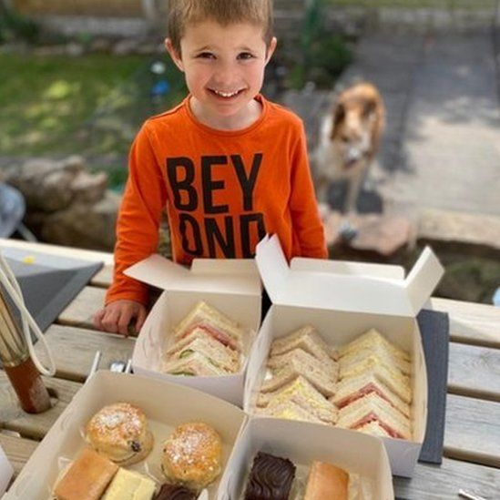 Claire Dinwiddy's son Seb, five, enjoyed the cream tea