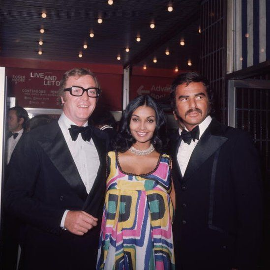 British actor Michael Caine, his wife Shakira, and Reynolds