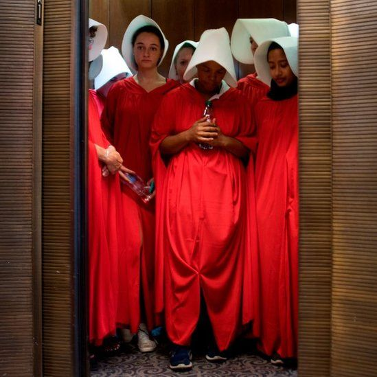 Protesters dressed as characters from The Handmaid's Tale