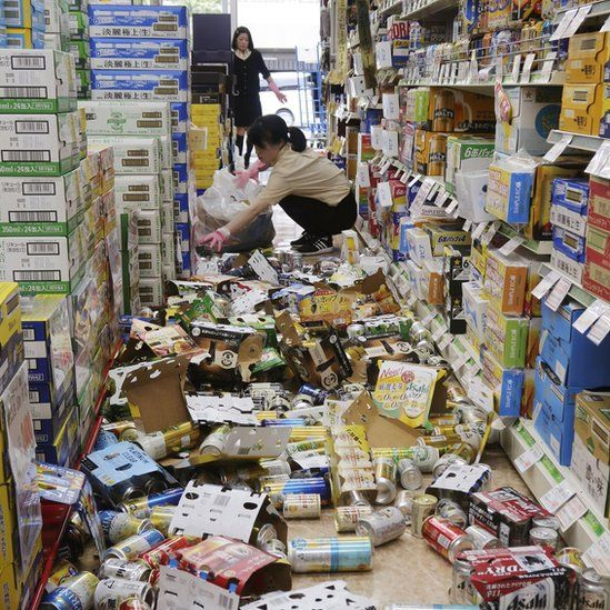 Supermarket with food fallen off the shelves