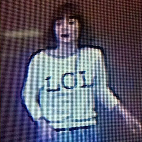 """Grainy image shows a woman with brown hair wearing a T-shirt with the letters """"LOL"""" emblazoned on it"""