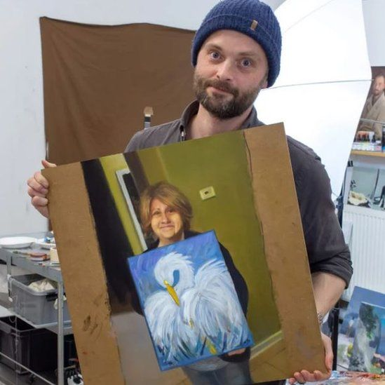 Kristoffer Zetterstrand with his painting of Cindi Decker and her painting