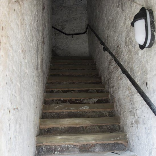 steps up the 'sally port'