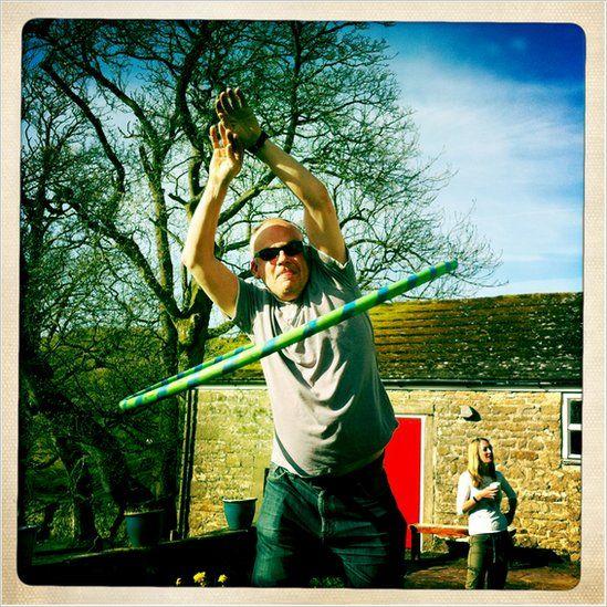 Man with hula hoop