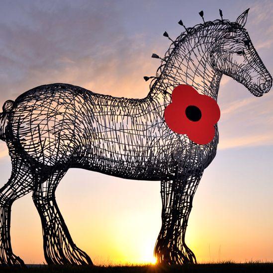 Andy Scott's horse sculpture wearing a poppy