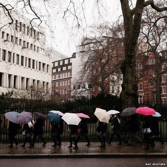 People carry umbrellas