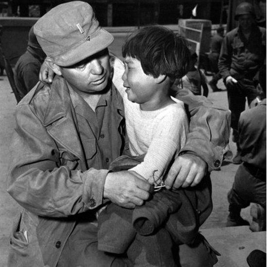 A picture dated May 23, 1951 shows a Korean orphan little girl crying in the arms of US lieutenant William Doernbach during Korean War. Doernabach had found her abandoned in her village in winter