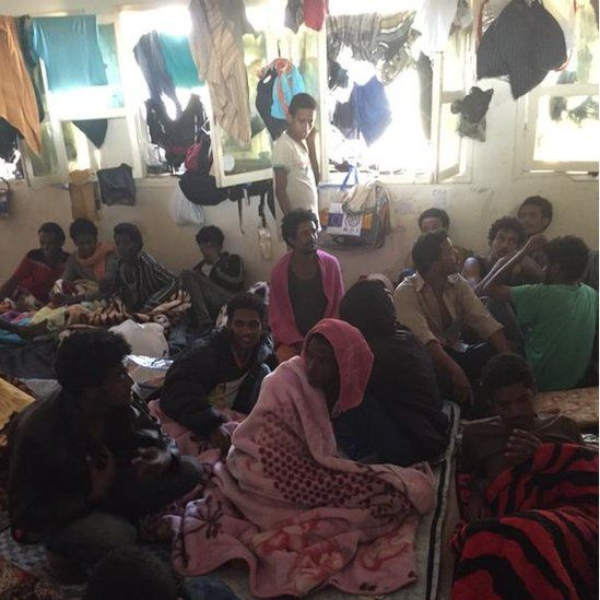 A room filled with migrants and washing