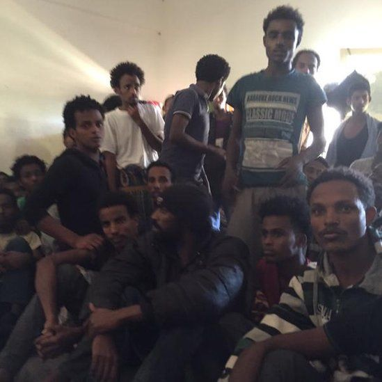 A group of men in the detention centre