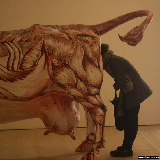 Woman looking at exhibit in art gallery