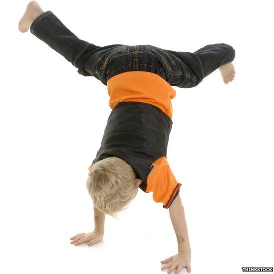 Child performing handstand