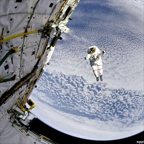 Astronaut Mark Lee tests the new Simplified Aid for EVA Rescue system aboard the Space Shuttle Discovery