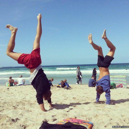 Handstand on a beach