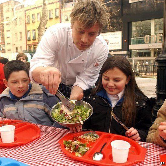 Jamie Oliver serves school dinners