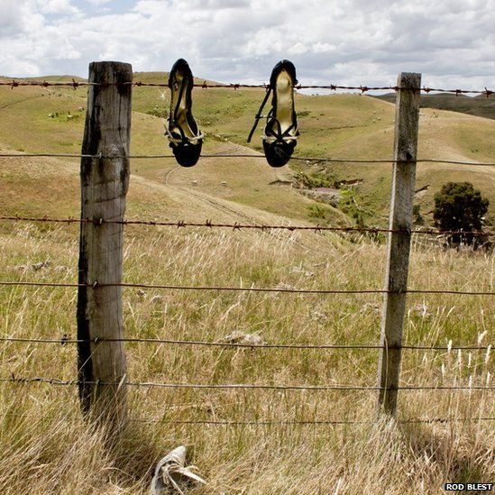 Shoes on a fence