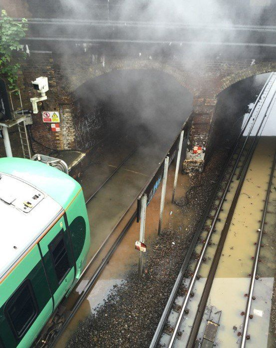 Smoke coming off flooded line in Norwood Junction