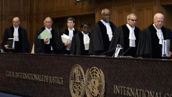 Judges take their seats at the International Court of Justice