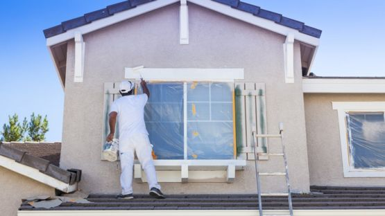 painter working on house
