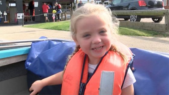 Daisy, six, defies doctors by completing a triathlon