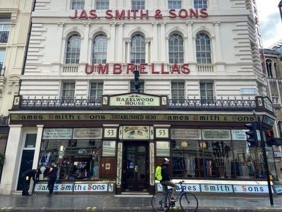 James Smith and Sons Umbrella shop with umbrellas in the window.