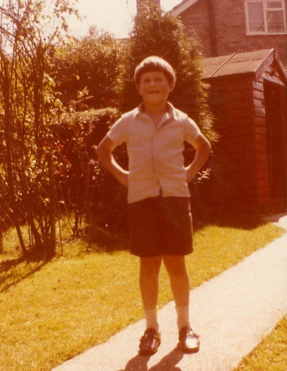 Robert as a child in shorts