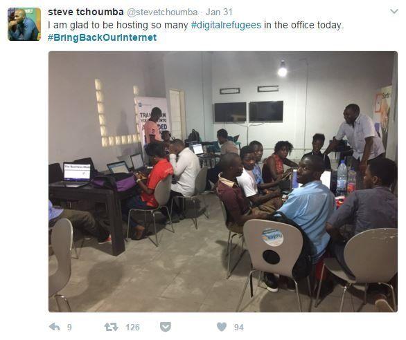 Tweet showing digital workers in an office
