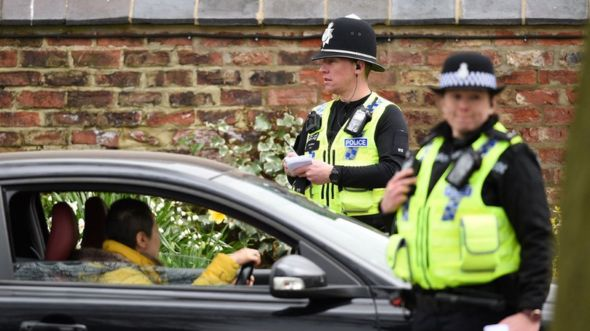 """Police officers from North Yorkshire Police stop motorists in cars to check that their travel is """"essential"""""""