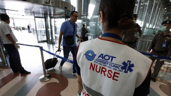 Thai officials monitor arrivals at Suvarnabhumi International Airport in Bangkok