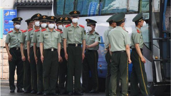 Police outside Xinfadi market