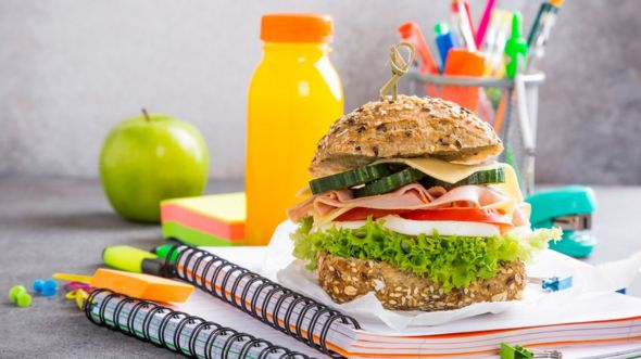 A lunch on a pile of notepads, back to school