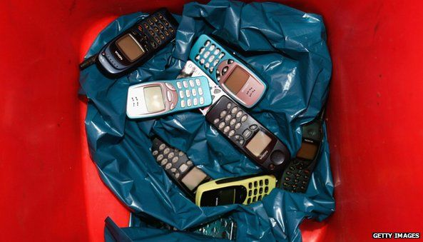 Nokia phones in a bin