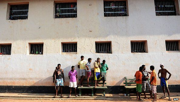 Sri Lankan prisoners look on during an event to celebrate Sinhalese and Tamil New Year at a prison complex in Colombo on April 24, 2013