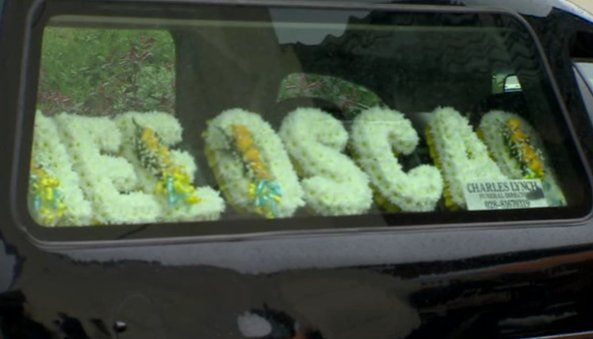A floral arrangement spelt out the name of 'Wee Oscar'