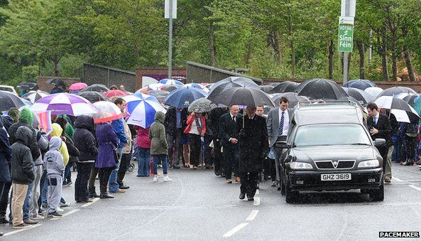 People lined the route of the procession