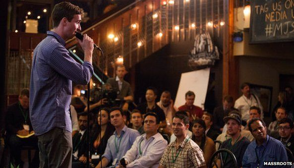 Man pitching crowd at Marijuana start up