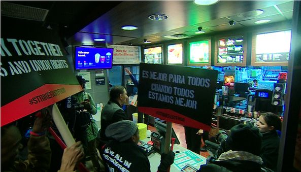 Workers in McDonalds with protest signs