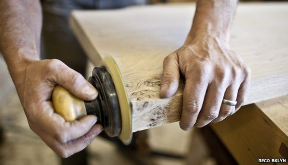Man sanding wood at Re-Co