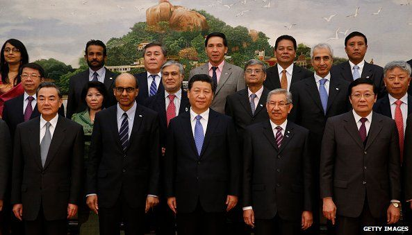 Chinese President Xi Jinping (C) poses at a meeting of representatives at the signing ceremony for the Asian Infrastructure Investment Bank at the Great Hall of the People on October 24, 2014 in Beijing, China.