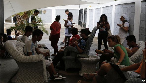 People use a free Wi-Fi network at a center run by famed artist Kcho, in Havana, Cuba, Wednesday, March 11, 2015.