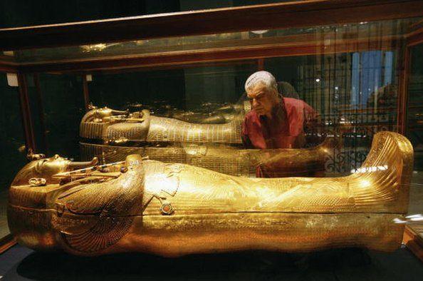 Dr Hawass looking at the sarcophagus of Tutankhamun