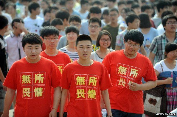 Students wear T-shirts saying 'fear nothing' as they walk into a room to write the 2014 'gaokao' college entrance exam in China in June 2014.